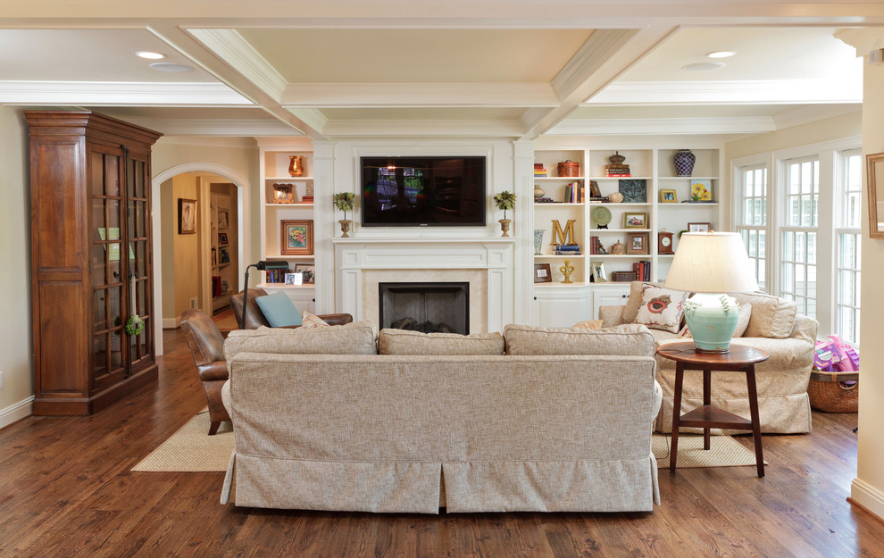 Hanging your tv over the fireplace yea or nay driven for Family room furniture layout tv fireplace