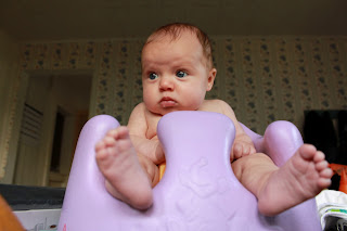 Lydia is able to sit and watch the world go by from the safetly of her lilac Bumbo baby seat