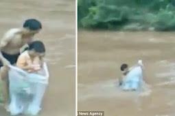 Terjang Banjir, Ayah Masukkan Anaknya dalam Kantong Plastik