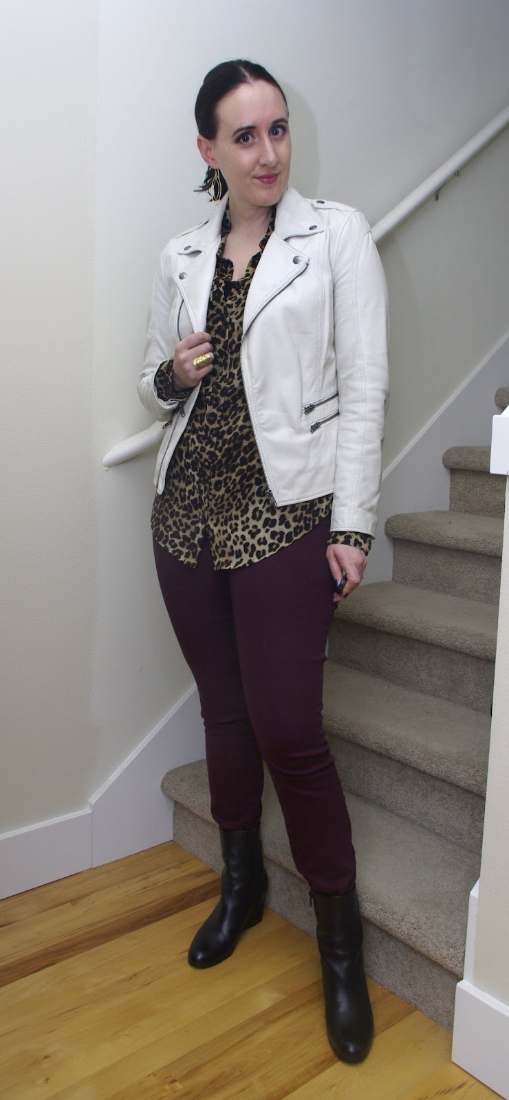 White leather moto jacket, leopard button-down blouse, burgundy skinny jeans, Vince wedge booties