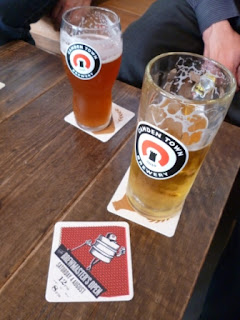 Some pints and a beermat advertising The Brewmaster's Open