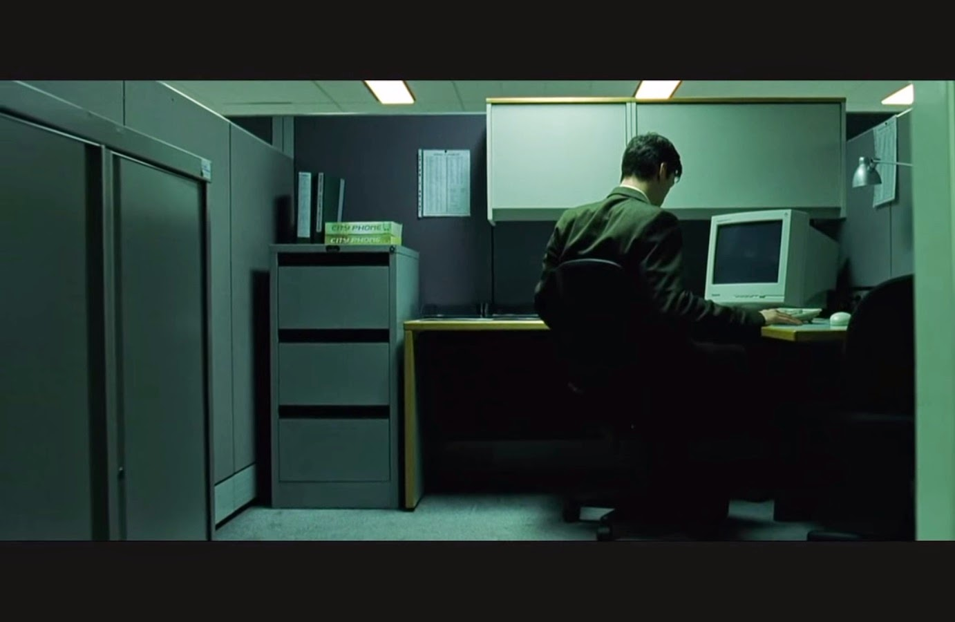 The Opening Dolly Shot Is Master For First Part Of Scene It Starts In Dark To Reveal Neo His Cubicle Boxed And Isolated As A
