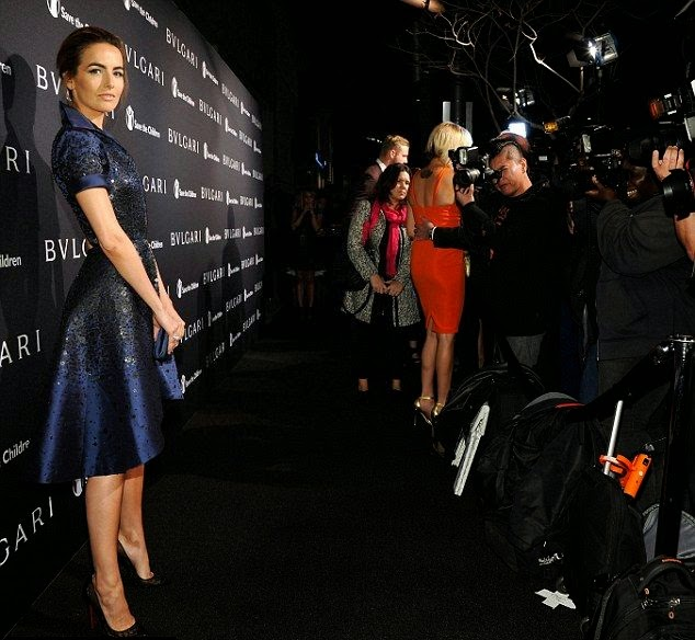 Camilla Belle, 28, just decided to turning her art in a blue satin dress as she headed the Bvlgari and Save The Children pre-Oscar event at Spago in Beverly Hills on Tuesday, February 17, 2015.