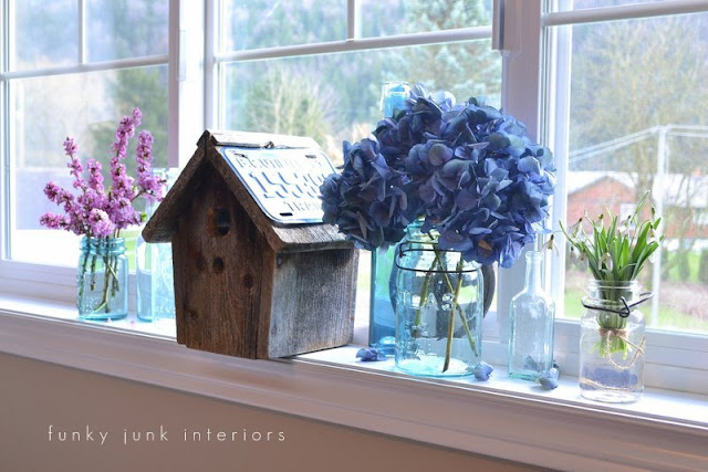Aqua mason jar flower vases on window sill via Funky Junk Interiors