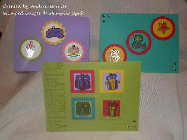 Three bright birthday cards featuring charms as the focal images.