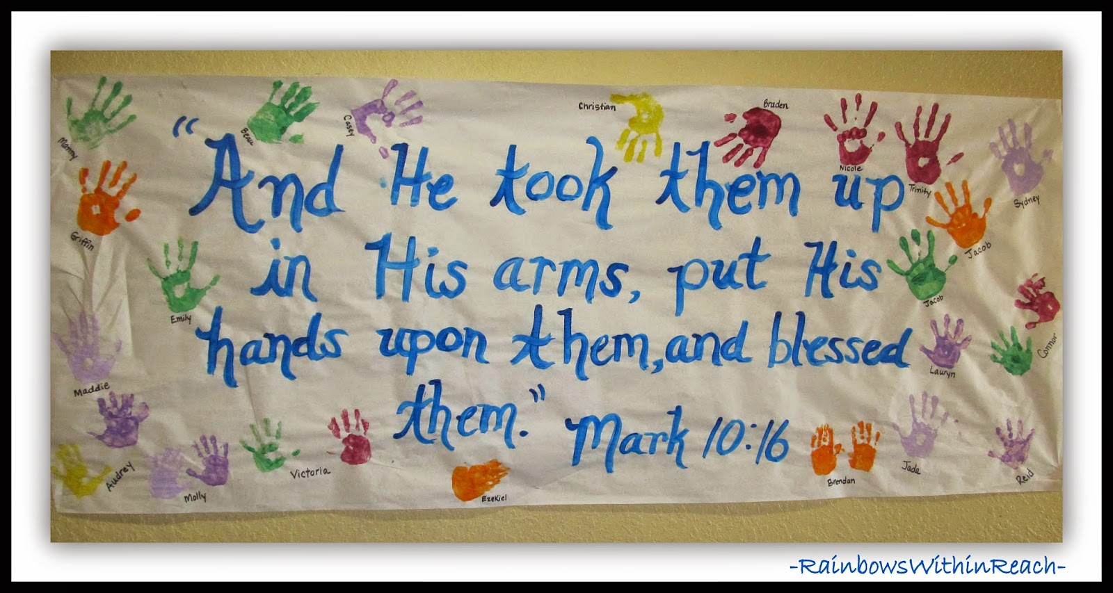 Hand Prints on Scripture Verse Bulletin Board at RainbowsWithinReach