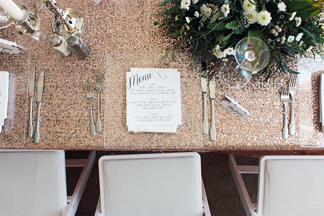 Elegant 50th birthday party. Beautiful party inspiration with earthy green centrepieces, rose gold sequinned linens and diy calligraphy.