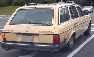 mercedes 300td hatchback car in puke yellow
