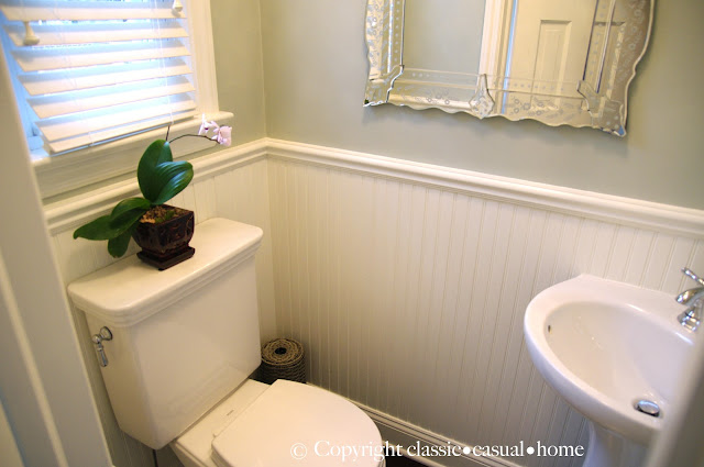 Classic casual home tiny powder room before and after for Powder room door size