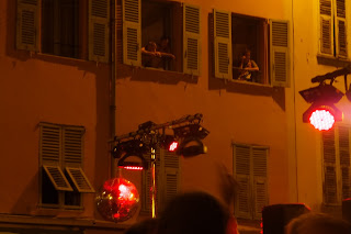 street party in Nice - people looking out of shuttered windows
