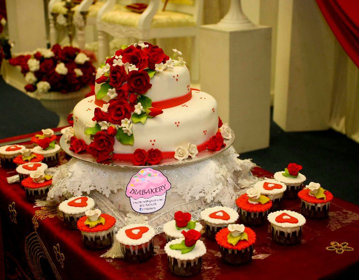 Fully fondant wedding cake with white and red theme complimented with set