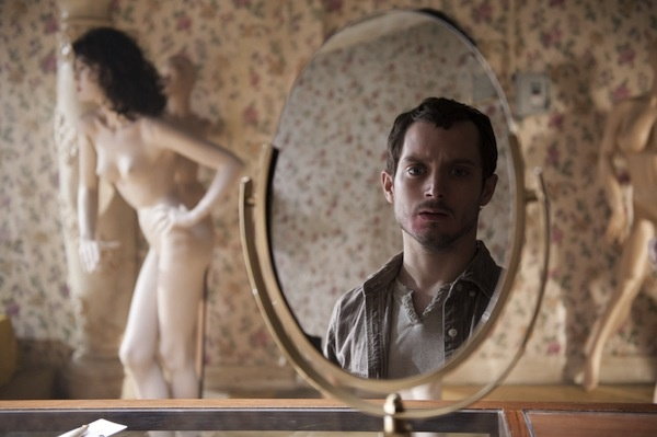 Elijah Wood staring at his reflection in Maniac