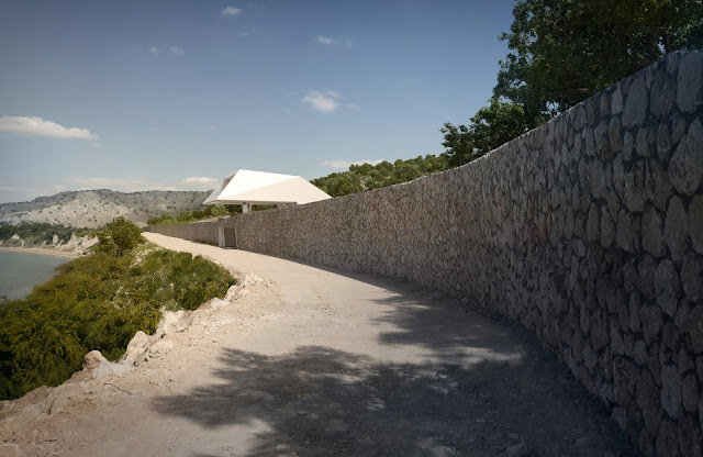 Stone wall with modern villa built above it