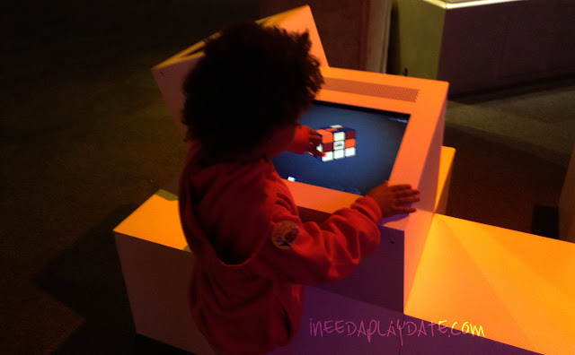 Solving a virtual Rubik Cube at Great Lakes Science Center this Summer #thisiscle | @mryjhnsn