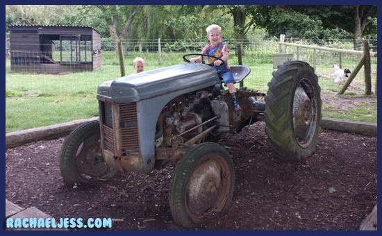 Playing on the tractor at Middle Farm