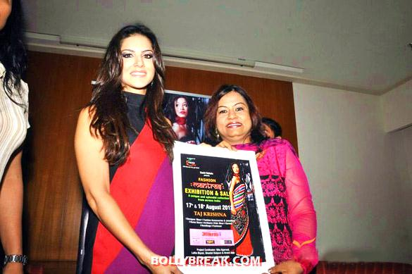 Sunny Leone holding exhibition poster - Sunny Leone at Akritti Fashion Mantras