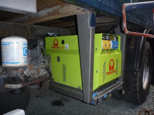 Pramac P4500 fitted behind batteries, air drier and air brake tanks