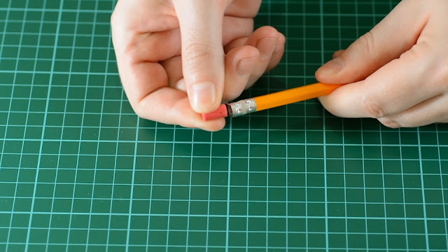 Remove the rubber from the pencil.