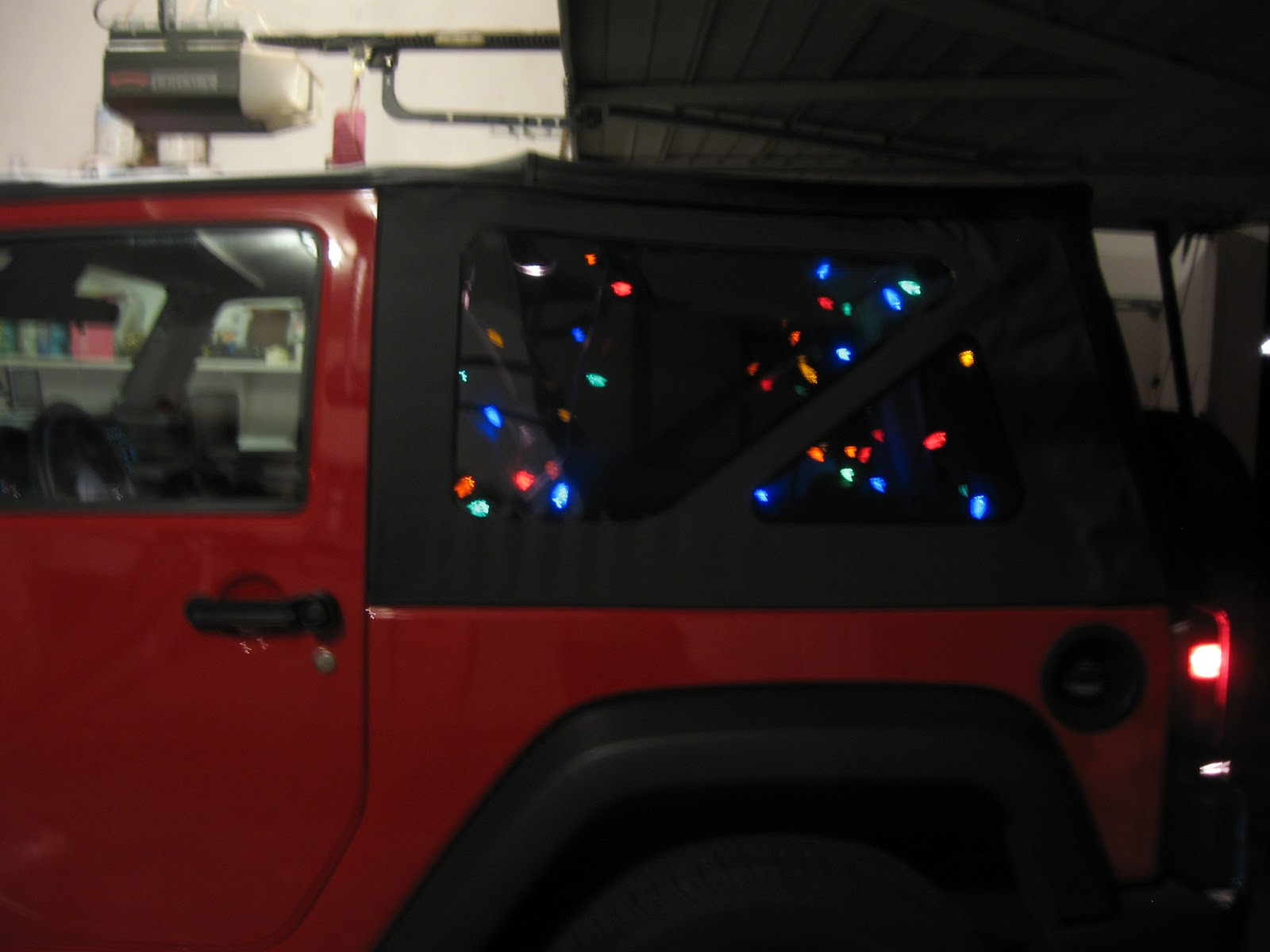 chris strung christmas lights in the back of the jeep he has an adapter that turns his cigarette lighter into a traditional household outlet to plug the - Jeep Christmas Decorations