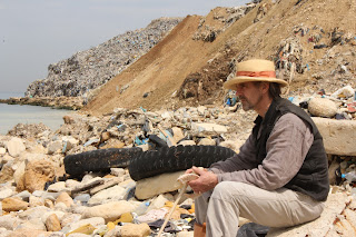 Jeremy Irons by a mountain of rubbish in Lebanon (in 'Trashed')