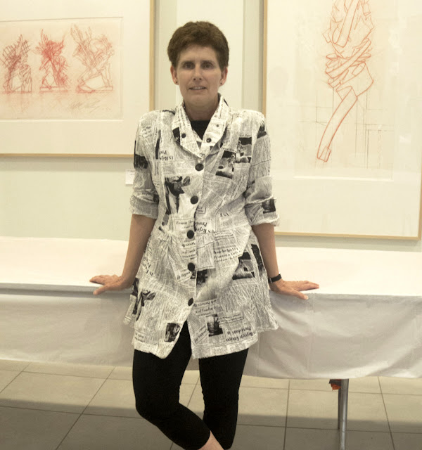RIT Associate Professor of Design Lorrie Frear wears a newspaper print shirt