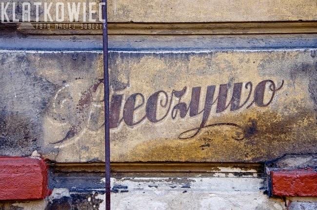 Kalisz. Napisy na murze - sklep kolonialny.