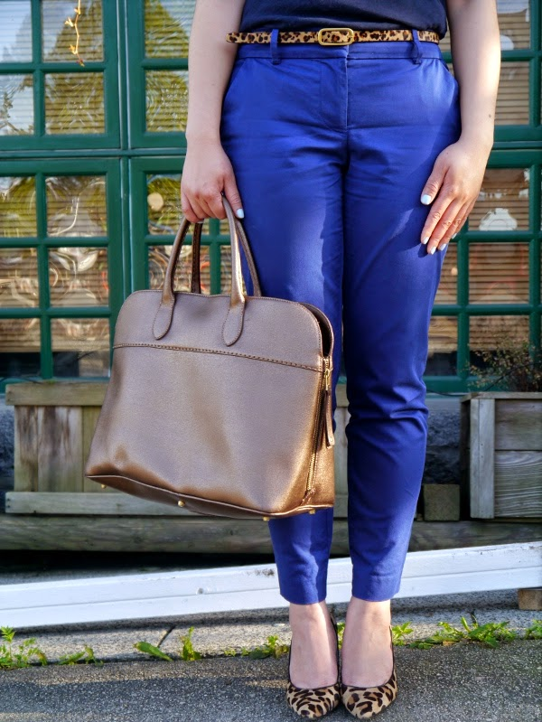 Leopard print, royal blue, and a gold metallic leather handbag