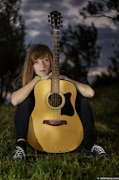 Young girl with Acoustic guitar