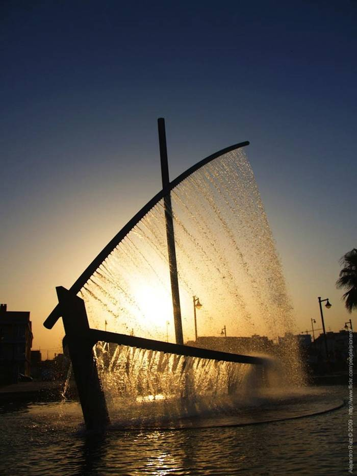 Playa de la Malvarrosa in Valencia, Spain and known simply as Water Boat Fountain (or Fuente del Barco de Agua in Spanish) by visitors and locals alike, the sculptural fountain creates the illusion of both the hull and the sail of a boat with liquid jets.