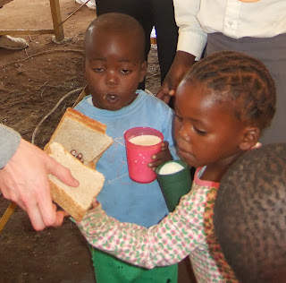 Peanut butter sandwiches and milk distributed at Kids Club in Leseding Township