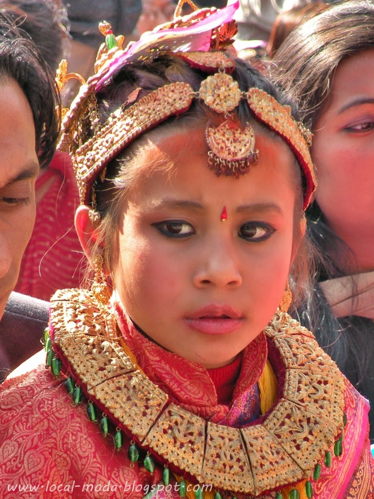 Nepali girl wearing traditional head ornament and necklace