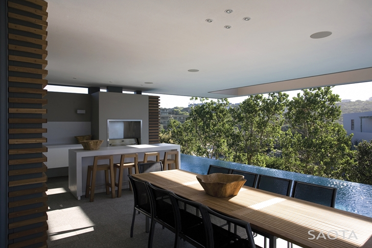 Open kitchen and dining room in Beautiful Plett 6541+2 Home by SAOTA