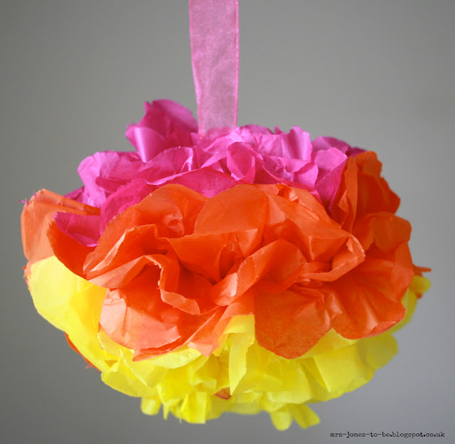 Paper pom poms - use folded tissue paper to create these fun decorations which will brighten up any celebration!