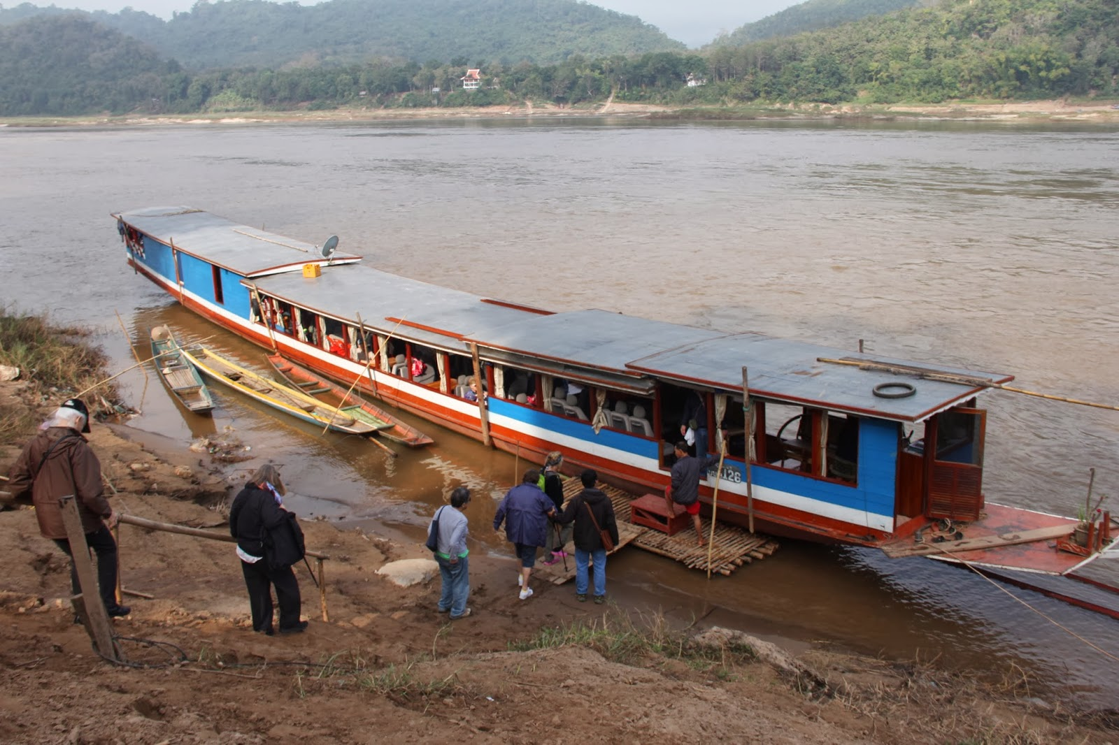Boarding the motor boat for a ride up the Mekong River.