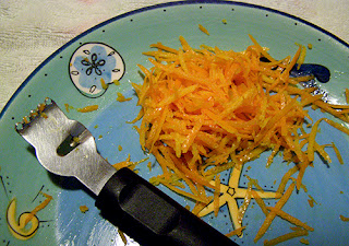 Orange Zest with Zesting Tool on Plate