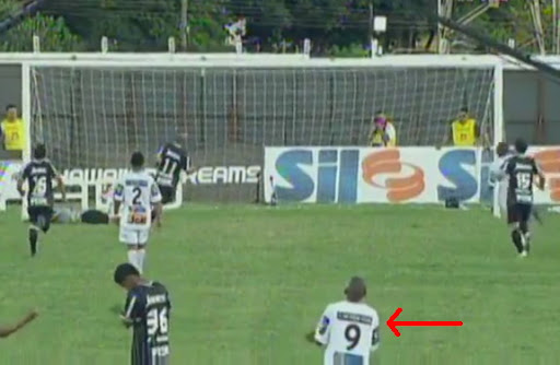 Comercial player Elionar Bombinha can't hide his happiness after his team conceded a goal