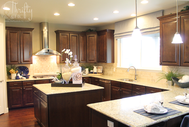 dark brown cabinets with light granite countertops in kitchen