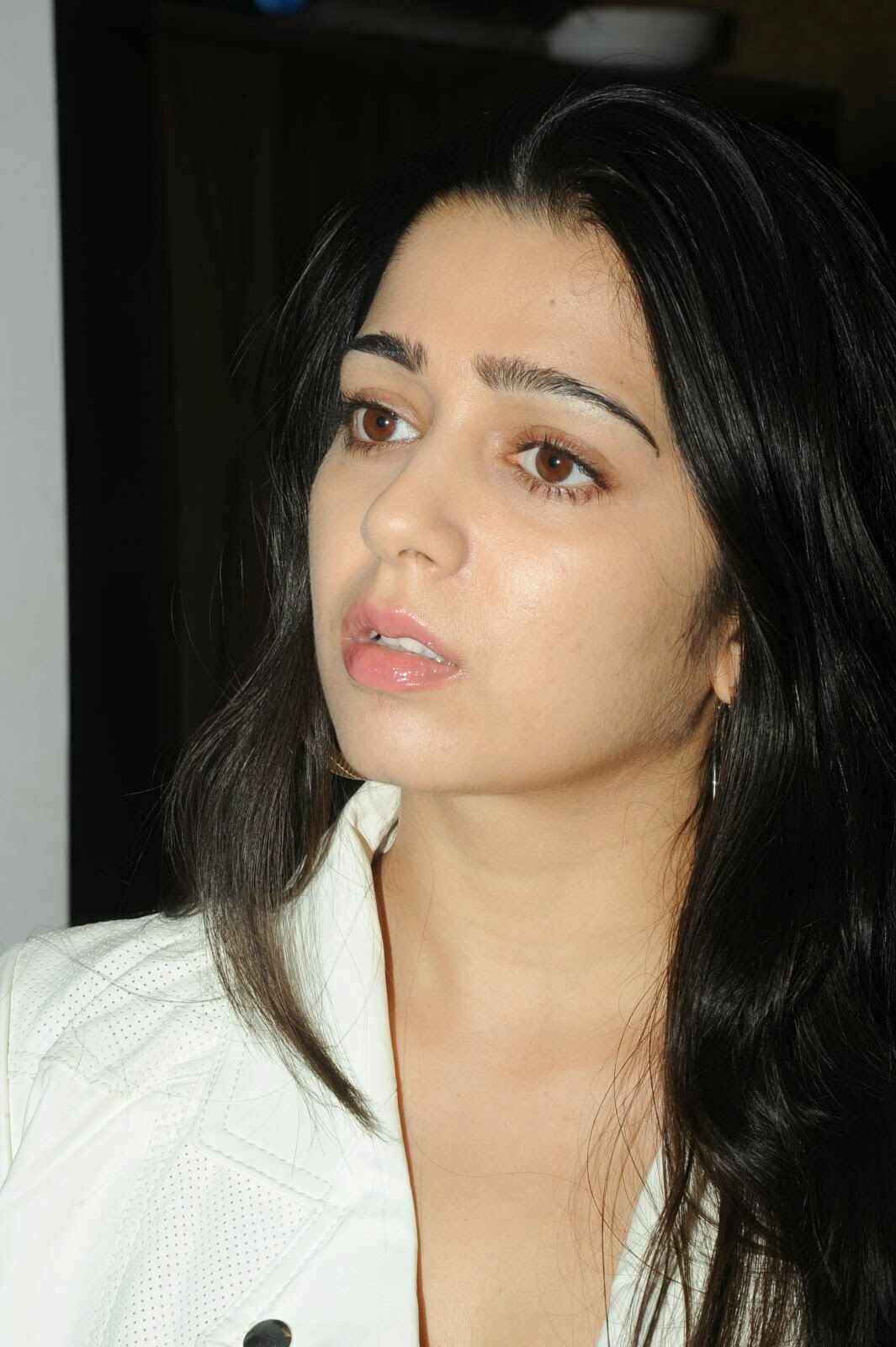Actress Charmi Kaur Pictures in Jeans at One by Two Movie Celetes 20 Years Event  0026.jpg