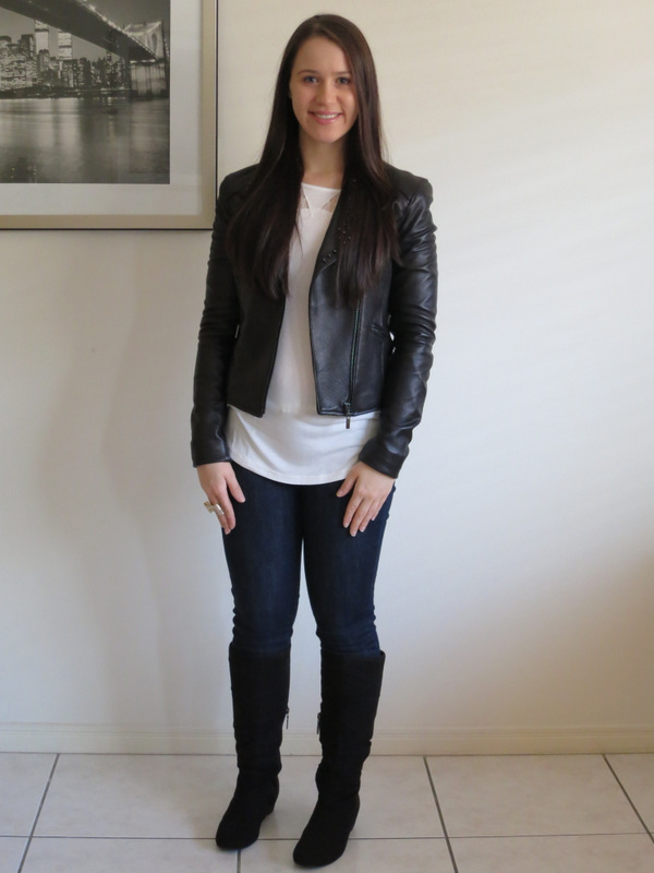 Dark wash denim jeans/leggings with a cram lace top, leather jacket and black wedge boots