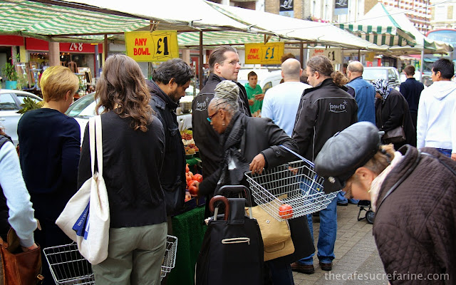 Shoppers at an open air farmer's market in London, England.