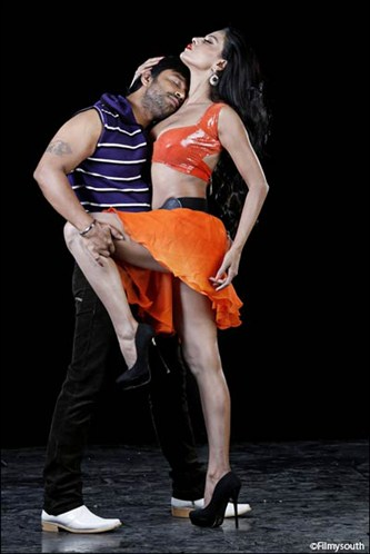 Veena Malik in a seductive pose wearing orange mini skirt  and black high heels -  Veena Malik's sensational THE DIRTY PICTURE photoshoot HOT PICS