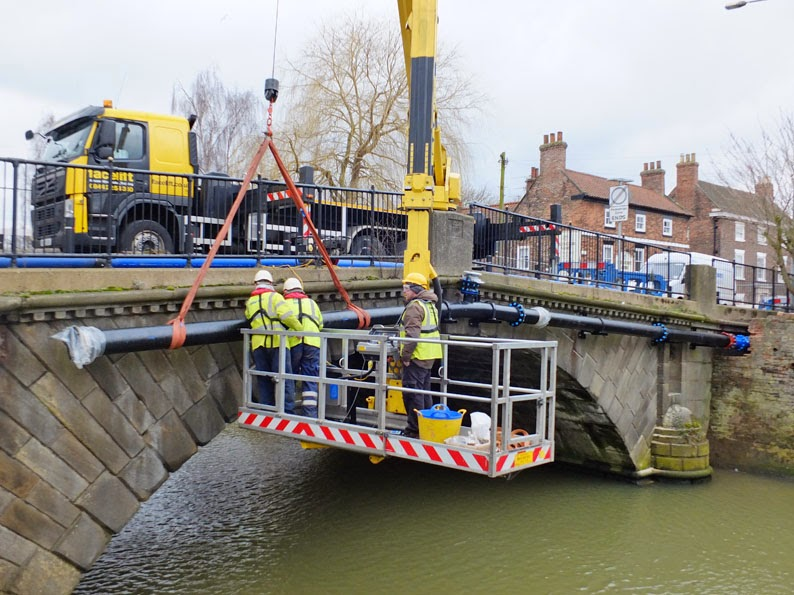 Balfour Beatty contractors busy on the replacement of the water main on the County Bridge in Brigg for Anglian Water. Ken Harrison caught up with them and took this picture from the towpath of the Old River Ancholme.
