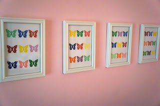 Make colorful nursery or playroom art with paint chips and a butterfly punch | A Crafty Wife