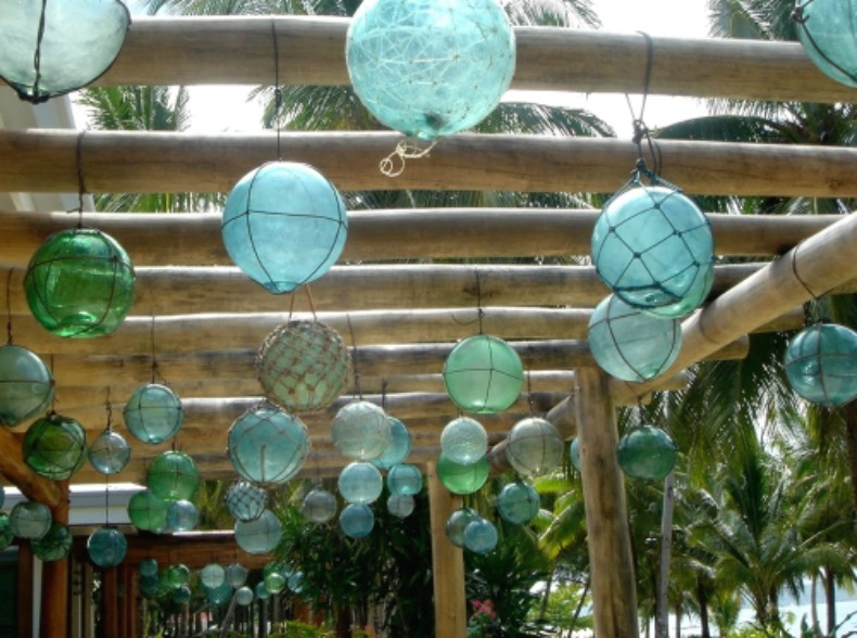 Sea glass floats hung outside
