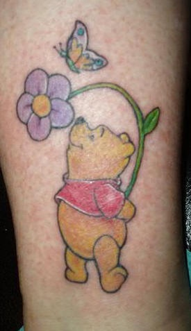 Winnie the pooh with flower and butterfly