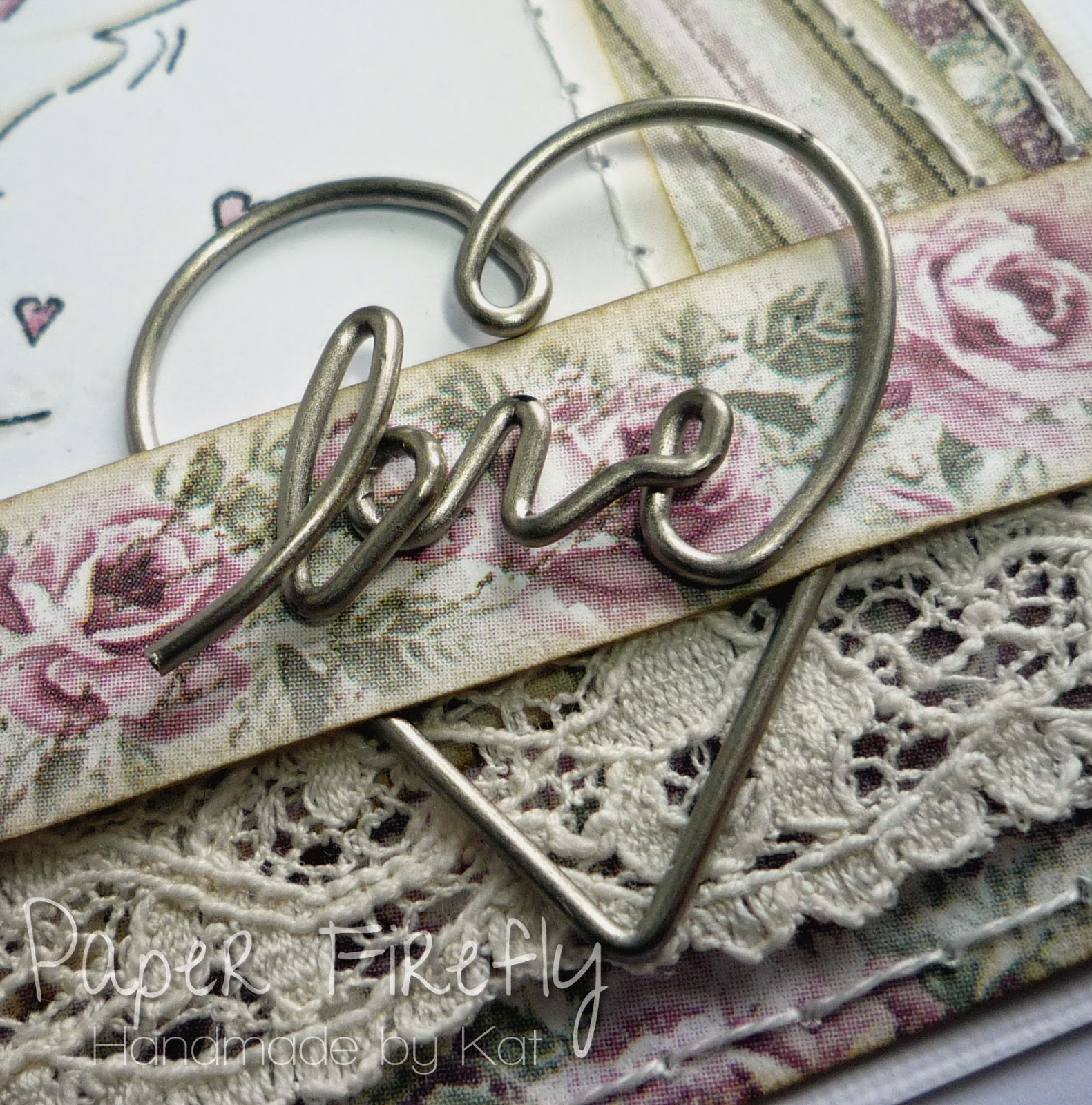 Metal heart embellishment from romantic vintage style wedding card with cute wedding couple
