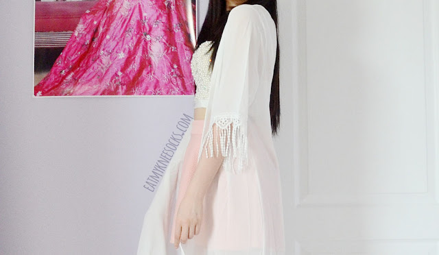Side view of the boho-style sheer white longline tassel-trim kimono from SheIn, along with the beaded bustier.