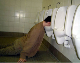 funny picture: drunk guy with the head in urinal