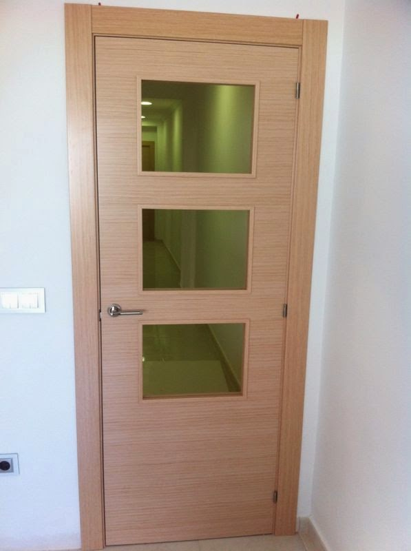 Puerta cristalera de tres vidrios de decape