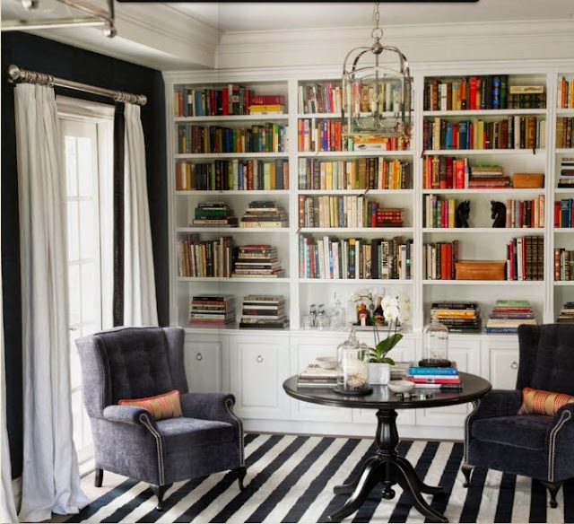 built in bookcases styling striped rug